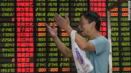 An investor reacts in front of screens showing stock market movements at a brokerage house in Shanghai on September 1, 2015. Shares in Hong Kong and Shanghai slid further on September 1 as data indicating factory activity in China hit a three-year low added to growing concerns about the world's number two economy. AFP PHOTO / JOHANNES EISELEJOHANNES EISELE/AFP/Getty Images