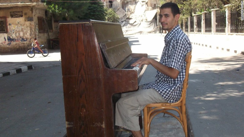 ISIS destroyed his piano, but he plays on