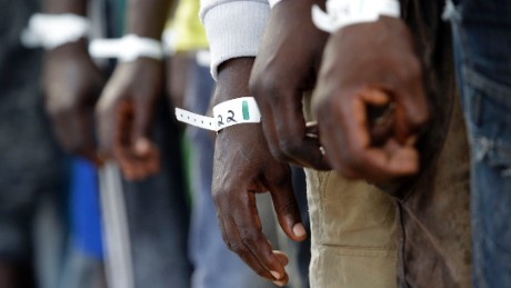 Migrants wear Id bracelets aboard of the Norwegian Siem Pilot ship during a migrant search and rescue mission off the Libyan Coasts, Tuesday, Sept. 1, 2015. Four dead bodies and hundreds of migrants were transferred on the Norwegian Siem Pilot ship from an Italian Navy ship and a Doctor Without Borders vessels after being rescued in different operation in the Mediterranean sea.
