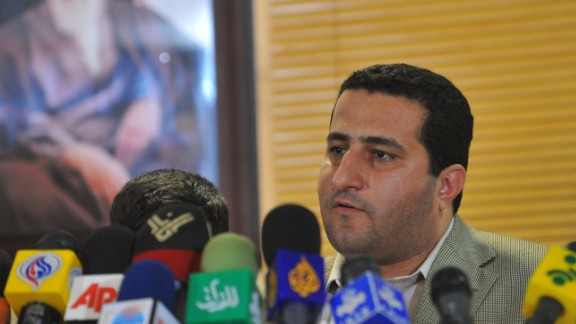 Shahram Amiri speaks to journalists during a press conference after arriving at Imam Khomini Airport July 15, 2010 in Tehran, Iran.