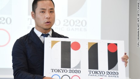 Tokyo Olympic logo designer Kenjiro Sano explains his design during a press conference on August 5, 2015. The designer later withdrew the emblem after a plagiarism controversy.