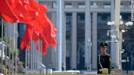 A paramilitary policeman stands at attention in Tiananmen Square in Beijing on September 2, 2015. China is preparing to hold a massive military parade on September 3, to commemorate the 70th anniversary of Japan's defeat in 1945 and the end of World War II. AFP PHOTO / WANG ZHAOWANG ZHAO/AFP/Getty Images
