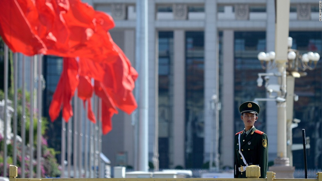 A paramilitary policeman stands at attention in Tiananmen Square in Beijing on September 2, 2015.