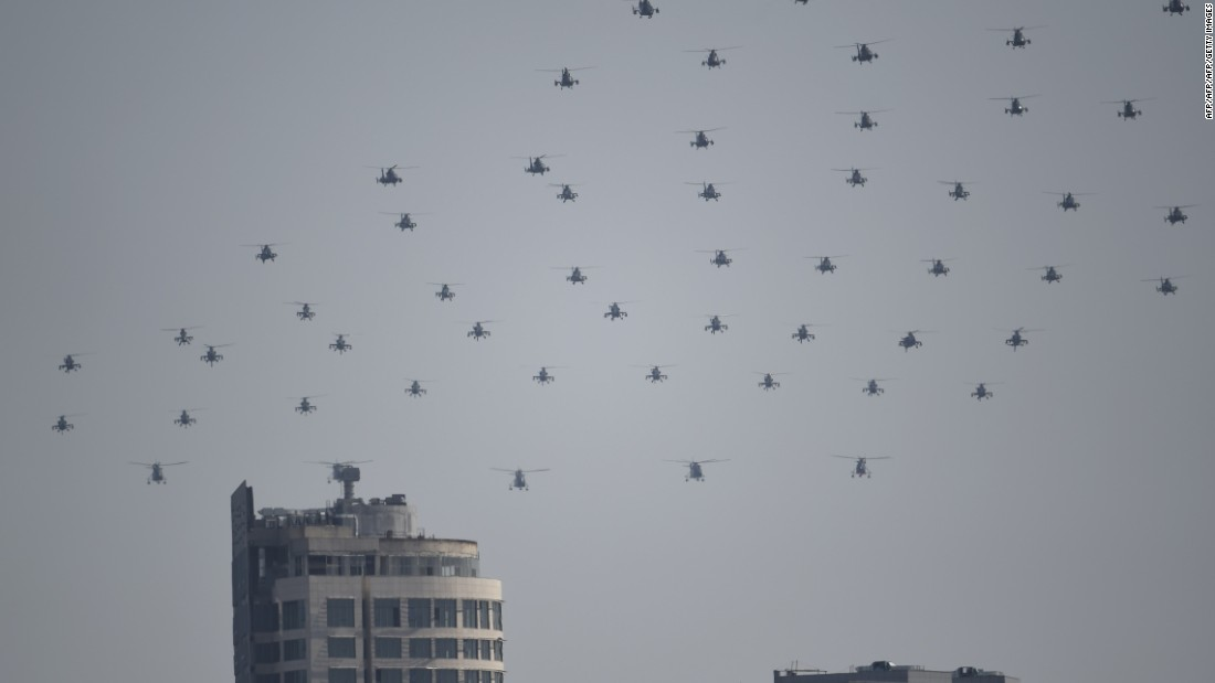 Chinese military helicopters fly in formation during the grand parade on September 3.