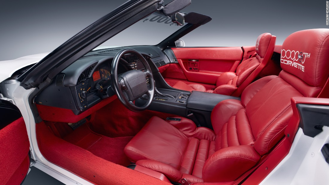 "In this photo of the restored car, you can see how GM lovingly restored the car's upholstery. The seats -- which feature one-of-a-kind ""1,000,000th Corvette"" embroidery on the headrests --  were deemed irreplaceable, so they were restored. A few replacement patches were necessary, requiring carefully matched hide."