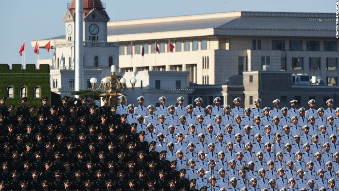 A Chinese military choir stands in position ahead of a military parade at Tiananmen Square in Beijing on September 3.