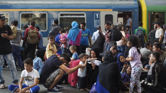 Migrants stand on the platform of the Keleti station waiting for a train. The station has become a focal point of the crisis currently engulfing parts of Europe, as an unprecedented wave of people -- mostly refugees fleeing conflict in Syria, Iraq and Afghanistan -- seek to reach Northern and Western Europe.