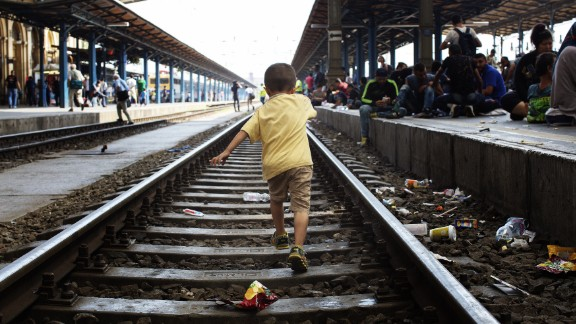 A child walks on the tracks of the Keleti railway station.