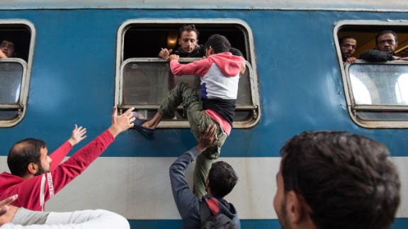 Migrants board a train at Keleti station in Budapest, Hungary, after the station was reopened in September 2015.