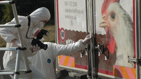 Investigators in Burgenland, Austria, inspect an abandoned truck that contained the bodies of refugees who died of suffocation in August 2015. The 71 victims -- most likely fleeing war-ravaged Syria -- were 60 men, eight women and three children.