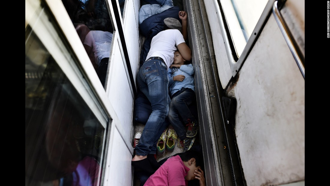 "Syrian refugees sleep on the floor of a train car taking them from Macedonia to the Serbian border in August 2015. <a href=""http://www.cnn.com/2015/08/28/world/iyw-migrant-how-to-help/index.html"" target=""_blank"">How to help the ongoing migrant crisis</a>"
