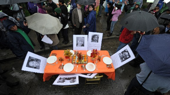 Angry that employees at Walmart and other retailers have to work on Thanksgiving, people have started protesting at stores over the holiday weekend.  Outside this Los Angeles Walmart, a dinner table was set with photos of Walmart workers who had to work on Thanksgiving, according to protest organizers.
