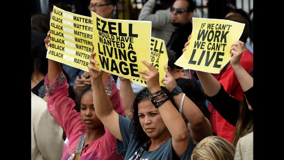 "Members of the Black Lives Matter movement, who connect the issues of racial justice and economic equality, attended a news conference at which Los Angeles Mayor Eric Garcetti signed a minimum wage increase into law in June. Ezell Ford, who was killed by Los Angeles police in 2014, ""would have wanted a living wage,"" reads one sign."