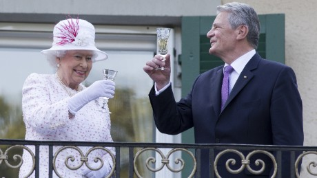 The Queen raises a glass with the President of Germany, Joachim Gauck, as they attend a garden party at the British Embassy residence on a state visit to Germany on June 25, 2015 in Berlin.