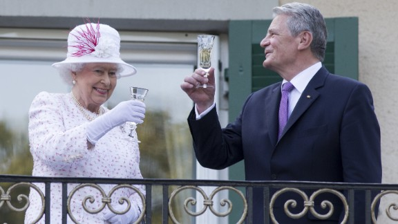 """The Queen raises a glass with the President of Germany, Joachim Gauck, as they attend a garden party at the British Embassy residence on a <a href=""""http://edition.cnn.com/2015/06/23/europe/uk-germany-queen-state-visit/"""">state visit </a>to the country on June 25, 2015 in Berlin."""