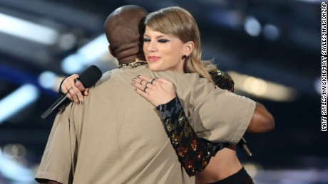 Taylor Swift, right, embraces Kanye West after presenting him with the video vanguard award  at the MTV Video Music Awards at the Microsoft Theater on Sunday, Aug. 30, 2015, in Los Angeles. (Photo by Matt Sayles/Invision/AP)