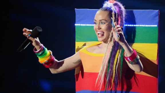 Channeling the 2015 Video Music Award incarnation of Miley Cyrus is arguably less controversial than the 2013 version. Play up the rainbows and stuffed animals and minimize the racial appropriation. Keep the crazy tongue wagging, though.