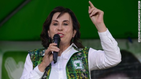 Guatemalan presidential candidate for the National Union of Hope (Union Nacional de la Esperanza) party, Sandra Torres, speaks during a campaign rally at El Milagro neighborhood in Guatemala City on August 26, 2015. General elections will take place next September 6 in Guatemala.
