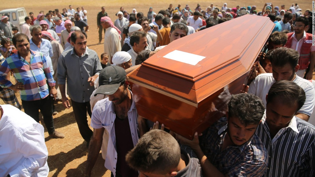 People carry a coffin during the funeral for Alan, Galip and the boys' mother, Rehen, in Kobani, Syria, on Friday, September 4, 2015. Alan's father brought their bodies back from Turkey for burial in the city they had fled.