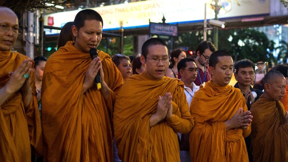 Monks pray at the Erawan Shrine on August 24 to commemorate the victims of the bombing.