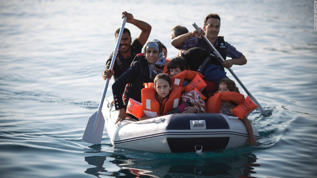 Tens of thousands of refugees are hopping in small boats and sailing from Turkey to Kos to seek asylum in Greece. Here, a Syrian family arrives in an inflatable dinghy at Kos on August 30.