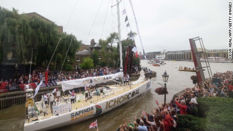 The IchorCoal clipper heads onto the river Thames in central London on August 30, 2015, as it moves into place to begin the 2015-16 Clipper Round the World Yacht Race.