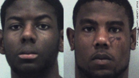 Gwinnett County Police booking photos of brothers Cameron, 17,  left, and Christopher Ervin, 22, arrested and charged with aggravated assault and arson in an alleged attack against their parents Yvonne and Zachary Ervin.