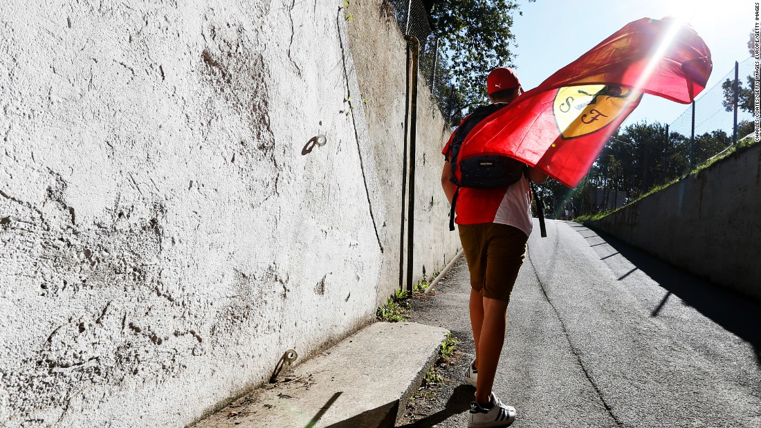 A Ferrari fan arrives at Monza ahead of the Italian Grand Prix. One of the most evocative and important tracks in the sport, it is a highlight of the Formula One season.