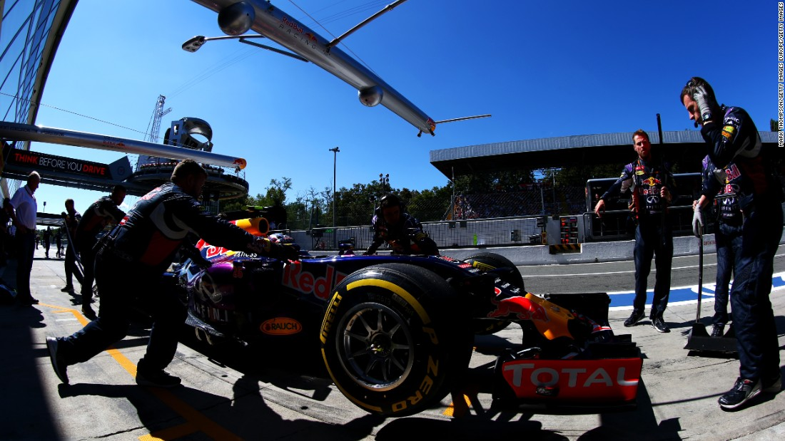 The car of Russian Red Bull driver Daniil Kvyat returns to the garage for a tune-up before the racing begins in earnest.