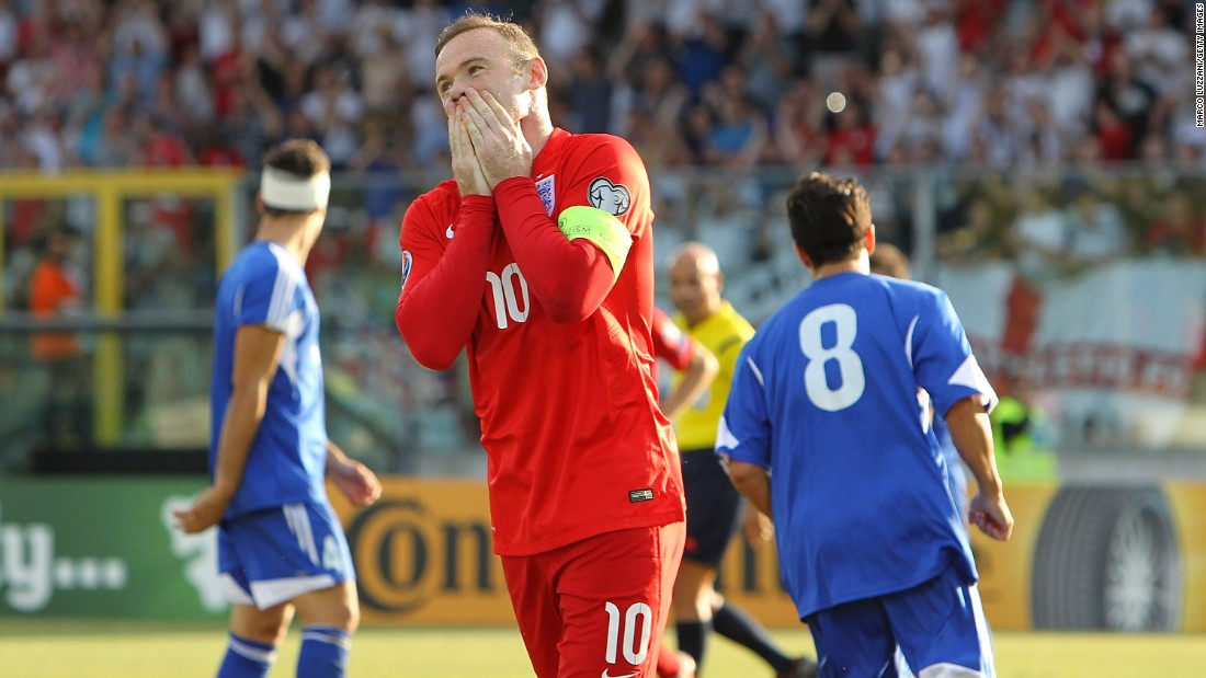 Wayne Rooney reacts after his opening goal against San Marino tied Bobby Charlton's record for most goals scored by an England player. Rooney's 49th international goal helped England claim a 6-0 victory on Saturday, September 5, and the team clinched a spot in next year's European Championship.
