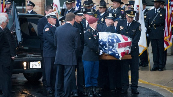 ANTIOCH, IL - SEPTEMBER 07: With his son (maroon beret) calling commands, the coffin of slain Fox Lake police officer Lt. Joe Gliniewicz is carried into Antioch Community High School for his visitation and funeral service on September 7, 2015 in Fox Lake, Illinois.  Gliniewicz was shot and killed on September 1, while on duty in Fox Lake. Police are searching for three suspects in connection with his death.  (Photo by Scott Olson/Getty Images)