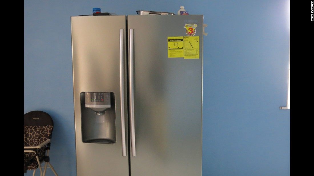 This refrigerator sat in the suspect's newly renovated kitchen. Authorities said scammers often talk their victims into sending new appliances to them. They planned to track the origins of this fridge.