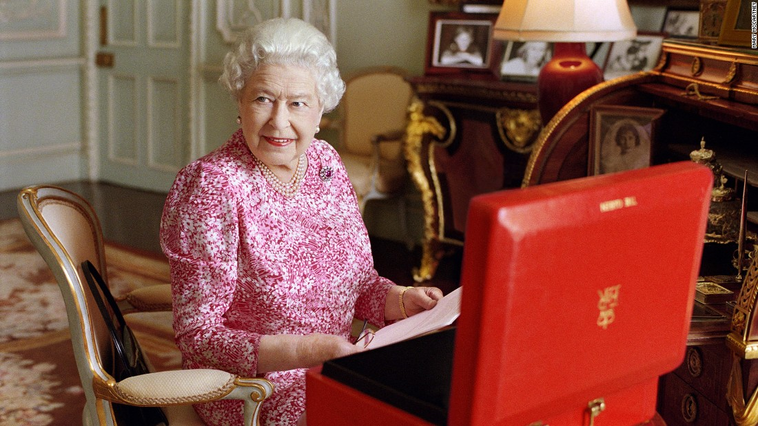 The Queen sits at a desk in Buckingham Palace in July 2015. In September of that year, she became the longest-reigning British monarch in history.