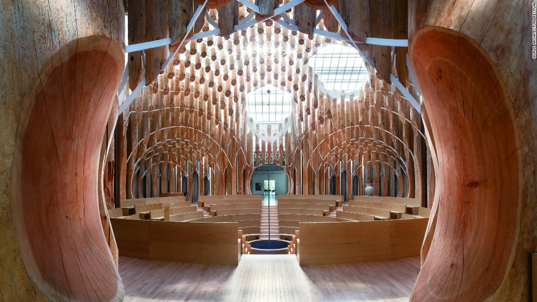The church's interior takes note of its mountainous and heavily forested surroundings -- its interior looks like an inverted treehouse, made of 834 differently sized pieces of Siberian red cedar wood. A cross is fixed in the middle of a pool of water.