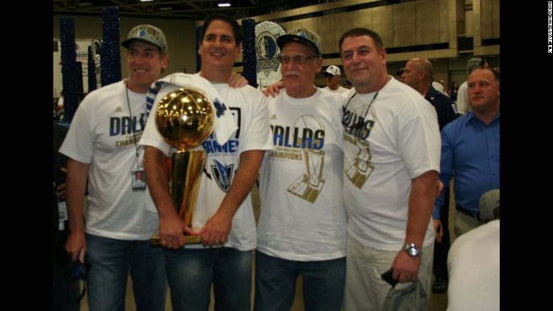 Brian Cuban, left, in 2011 next to his brother, Dallas Mavericks owner Mark Cuban, after the team's championship win. This was six years after Brian's suicide attempt.