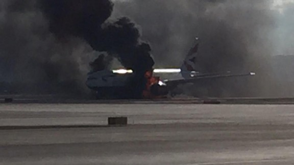 Thick black smoke billows out of British Airways Flight 2276 on Tuesday in Las Vegas.