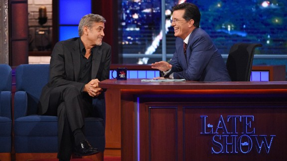 "Stephen Colbert talks with George Clooney during the premiere episode of ""The Late Show,"" which he took over on Tuesday, September 8. Colbert's rise includes a number of notable moments."