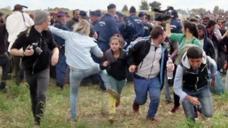 This video grab made on September 9, 2015 shows a Hungarian TV camerawoman kicking a child as she run with other migrants from a police line during disturbances at Roszke, southern Hungary. After the footage appeared, the camerawomen was fired on September 8 by N1TV, an internet-based TV station close to Hungary's far-right Jobbik party. The woman, later named as Petra Laszlo, can be seen tripping a man sprinting with a child in his arms, and kicking another running child in two separate incidents. The scenes took place as hundreds of migrants broke through a police line at a collection point close to the Serbian border where thousands have been crossing over each day for the past month.     AFP PHOTO / INDEX.HU        (Photo credit should read -/AFP/Getty Images)