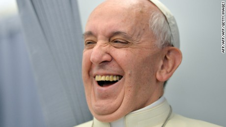Pope Francis laughs while addressing journalists of the papal flight, upon arrival in Rio de Janeiro on July 22, 2013. Pope Francis landed in Brazil on Monday for his first overseas trip as pontiff to attend the international festival World Youth Day in Brazil, the world's biggest Catholic country.    AFP PHOTO/LUCA ZENNARO/POOL        (Photo credit should read LUCA ZENNARO/AFP/Getty Images)