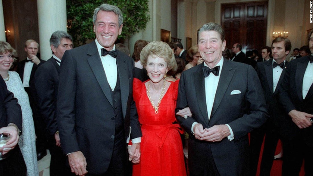 "One-time Hollywood colleagues, President Ronald Reagan and first lady Nancy Reagan invited Hudson to a White House state dinner in May 1984. Hudson found out he had AIDS a month later, a diagnosis he kept secret from all but a few friends for more than a year. <a href=""http://articles.latimes.com/1985-09-20/news/mn-6330_1_aids-project"" target=""_blank"">Ronald Reagan, who called Hudson while he was hospitalized, didn't refer to AIDS publicly</a> until shortly before the star's death in 1985; he didn't give <a href=""http://www.nytimes.com/1987/06/01/us/reagan-urges-wide-aids-testing-but-does-not-call-for-compulsion.html"" target=""_blank"">a formal speech on the health crisis until May 1987</a>."
