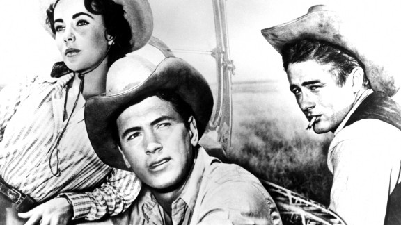 "Hudson scored his only Oscar nomination as Bick Benedict in the 1956 epic ""Giant,"" with Elizabeth Taylor as his wife and James Dean, right, as his rival. He played a stubborn cattle rancher battling change in oil-rich Texas in the George Stevens film based on Edna Ferber's novel. Taylor, a good friend, later became a passionate AIDS activist. A year after ""Giant,"" Hudson topped the list of box-office stars in America. He continued to appear in the Top 10 through 1964."