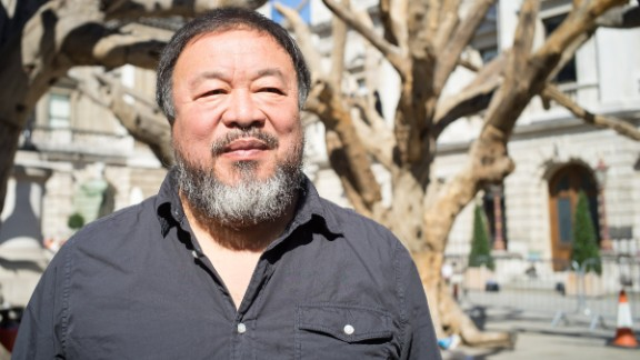 The Chinese artist Ai Weiwei is attending an exhibition of his work outside China for the first time in five years. He was granted a passport this July by the Chinese authorities, four years after it was confiscated.  Here, he stands among his trees at the Royal Academy of Arts in London.