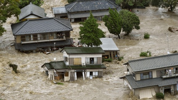 People wait to be rescued as houses are submerged in Joso on September 10.