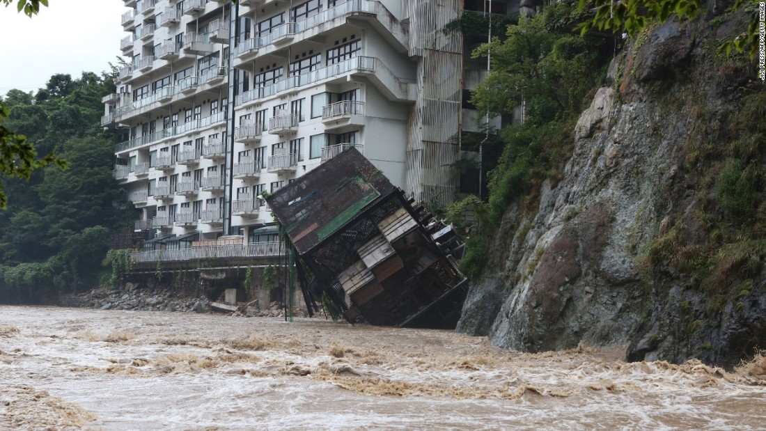 A hotel building plunges into floodwaters at a mountain resort in Nikko, Japan, on September 10.