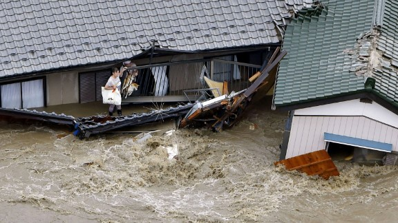 People and dogs wait for rescuers in Joso on September 10.