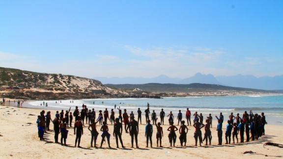 Warming up on the beach with a safe circle. Safe circles encourage sharing and create a respectful culture.