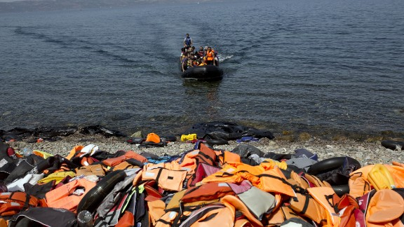 Discarded life jackets line the rocky shores of Lesbos, Greece on September 10, 2015. The remnants of inflatable boats also litter the beach. Migrants are advised to slash their rafts when they arrive so that authorities can