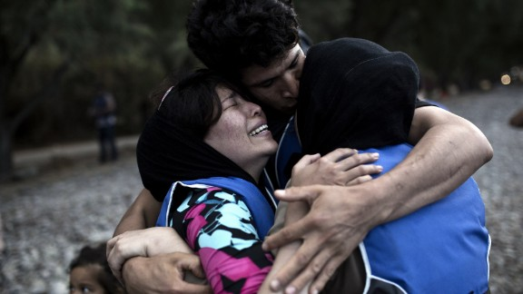 A woman cries after arriving on the island of Lesbos, after crossing the Aegean Sea from Turkey on a dinghy on September 10.