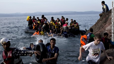 Migrants arrive on the Greek island of Lesbos after crossing the Aegean Sea.