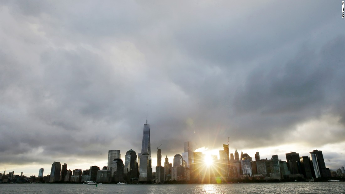 The sun rises over Lower Manhattan and One World Trade Center, at left, on Friday, September  11, in a view from Jersey City, New Jersey. The nation is marking the 14th anniversary of 9/11, the deadliest terrorist attack on U.S. soil. Nearly 3,000 people died that day. See other images of 9/11 events: